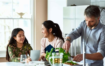 Stock photo of young family in kitchen preparing healthy meal
